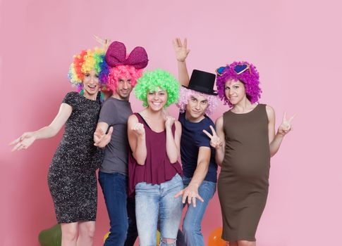 Group of young people disguised for a party.