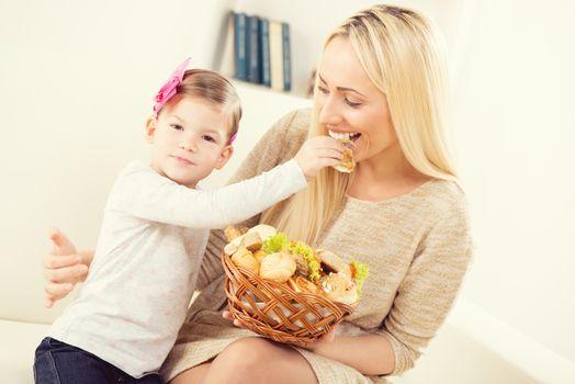Daughter Feeding Mom