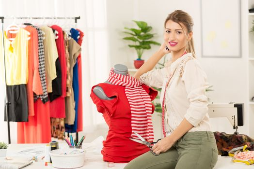 Fashion Designer With Creation On Mannequin