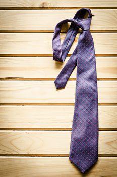 necktie on rustic wood.