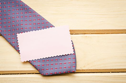 Blank tag with necktie
