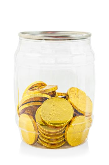 Gold chocolate coin in bottle.