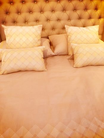 Luxurious bed with silky linen