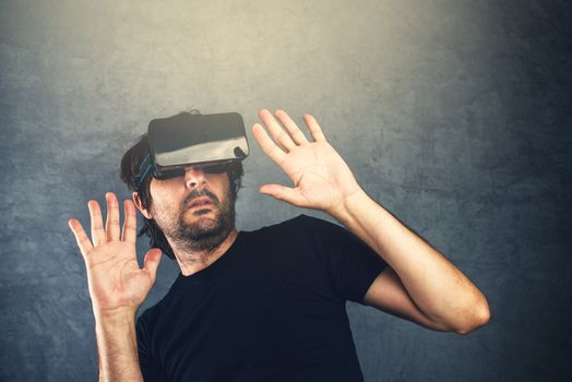 Scared man with virtual reality goggles