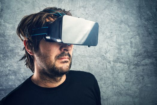 Man with 3d VR goggles enjoying virtual reality