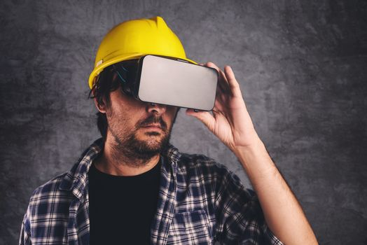 Construction engineer with VR goggles managing building project