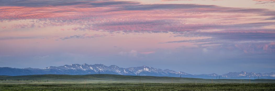 panorama of Medicine Bow Mountains at dusk in early summer, North Park, Colorado near Cowdrey