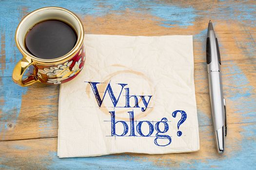 Why blog question - handwriting on a napkin with a cup of coffee