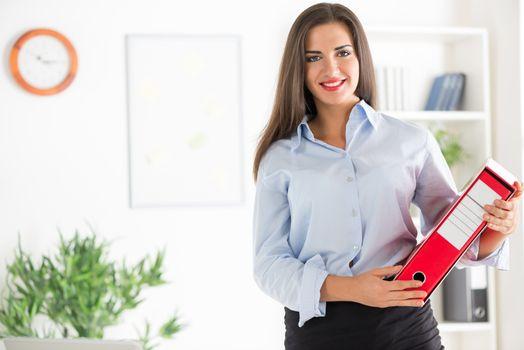 Businesswoman With Binder