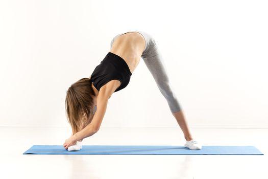 Flexible Girl Doing Stretching Exercises