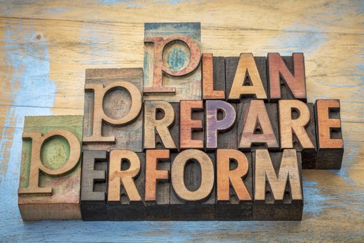 plan, prepare, perform  - motivational word abstract in vintage letterpress wood type