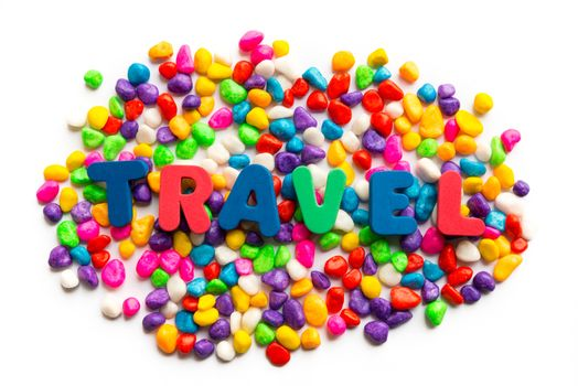 travel word on colorful stone