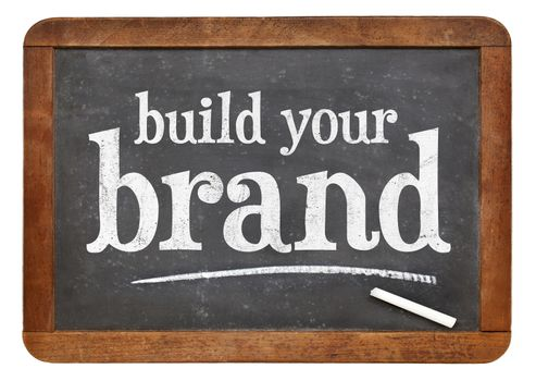 build your brand  - white chalk text on a vintage slate blackboard