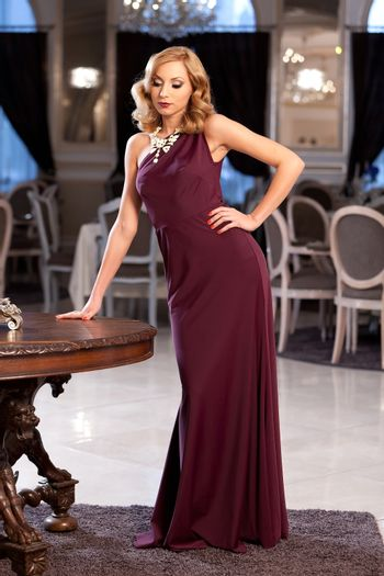 Sensual blonde wearing an elegant dress. Please see more imeges from the same shoot.