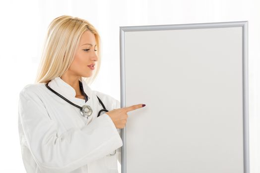Female Doctor With Noticeboard