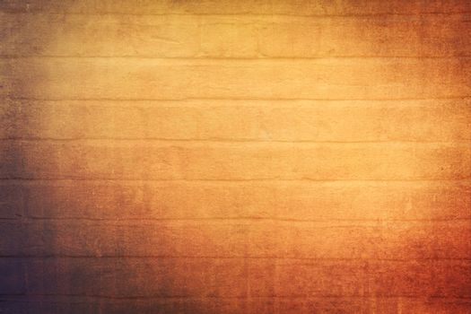 Bright warm red and orange brickwall texture and background
