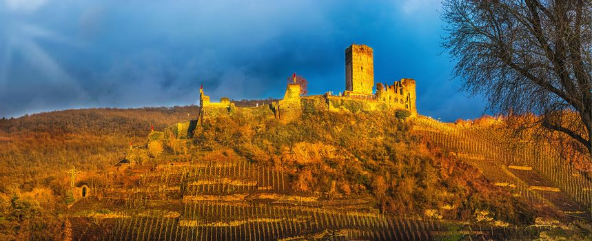 Artistic work of my own. HDR processing.  Old Postcard. Panorama, Burg Metternich on the Mosel in Germany against a dramatic sky.