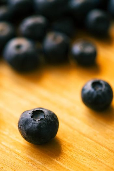 Blueberries on wooden table, macro