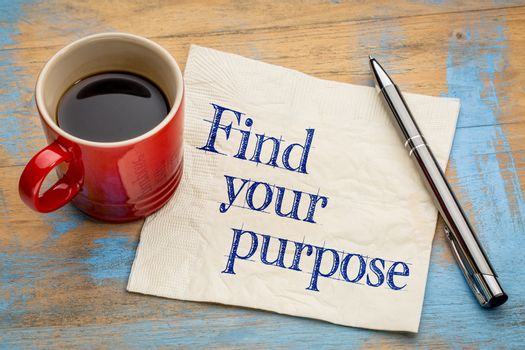Find your purpose advice or reminder - handwriting on a napkin with a cup of espresso coffee