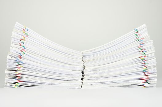Dual pile overload document place on white background