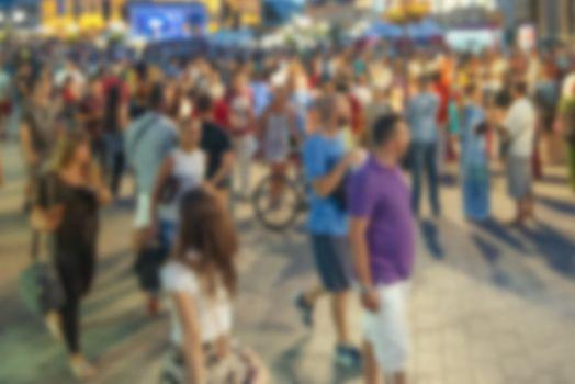 Blur street crowd in summer evening