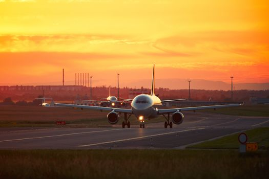Airport traffic at the sunset