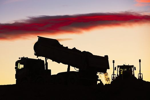 Silhouette of the truck in the building site