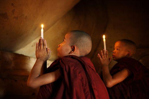 Buddhist novices praying