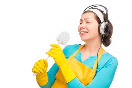 humorous photo housewife with headphones and a cleaning brush to