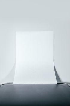 Office desktop laser printer with blank paper as copy space