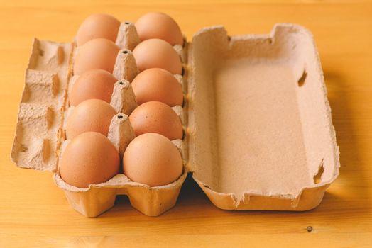 Ten eggs in cardboard box
