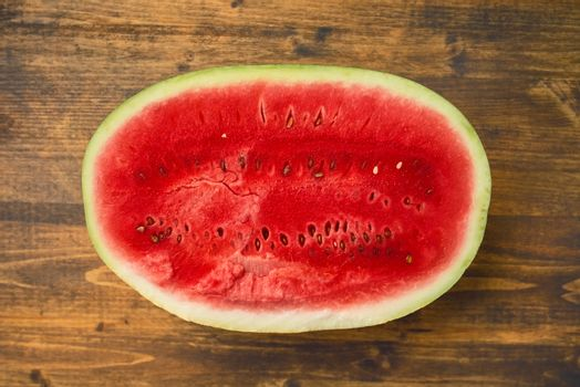 Watermelon half on rustic table