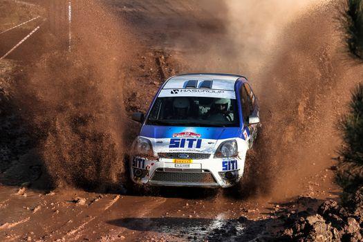 ISTANBUL, TURKEY - NOVEMBER 14, 2015: Billur Hasbay drives Ford Fiesta ST in Isok Istanbul Rally 2015, Gocbeyli stage