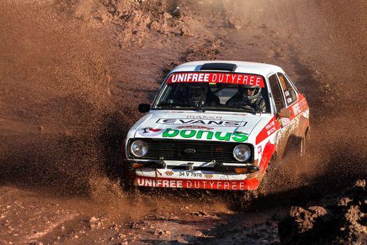 ISTANBUL, TURKEY - NOVEMBER 14, 2015: Engin Kap drives Ford Escord MK2 of Bonus Unifree Parkur Racing Team in Isok Istanbul Rally 2015, Gocbeyli stage