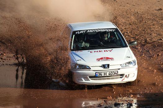 ISTANBUL, TURKEY - NOVEMBER 14, 2015: Murat Ucbasaran drives Peugeot 306 in Isok Istanbul Rally 2015, Gocbeyli stage
