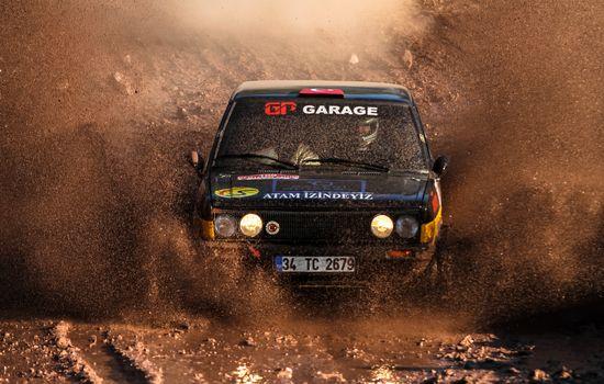 ISTANBUL, TURKEY - NOVEMBER 14, 2015: Eris Okutan drives Murat 131 in Isok Istanbul Rally 2015, Gocbeyli stage