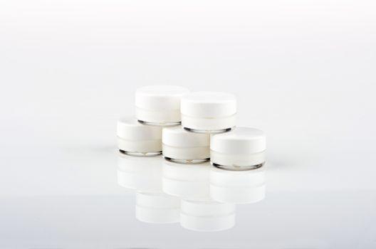 Blank white facial cream jar isolate on white background