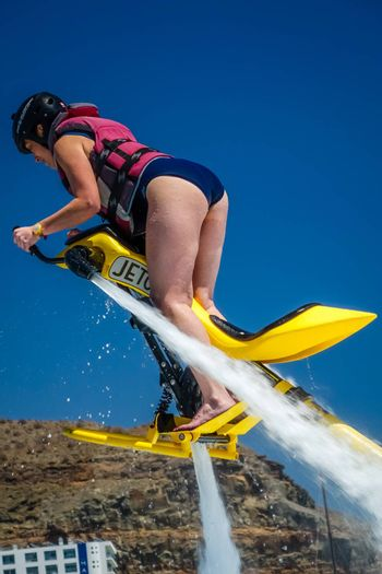 Woman hovering above water on a jet ski in Gran Canaria, Spain. Picture taken 8 May 2015.