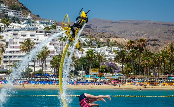 Woman falling down into water from a jet ski in Gran Canaria, Spain. Picture taken on the 8th May 2015.