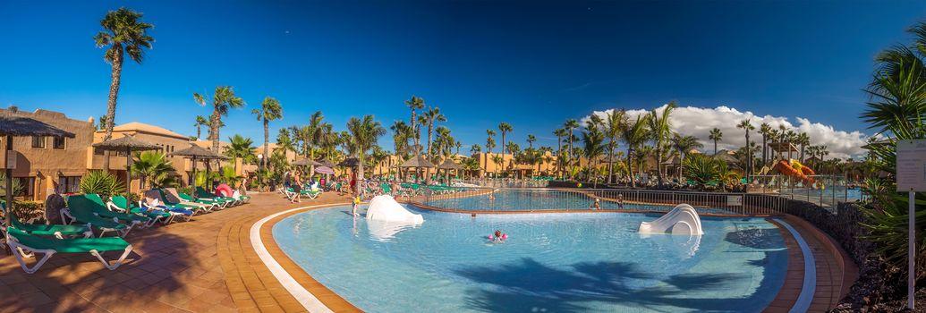 Children having fun inside large swimming pool in a resort in Fuerteventura, Canary Islands, Spain. Picture taken 16 April 2016.