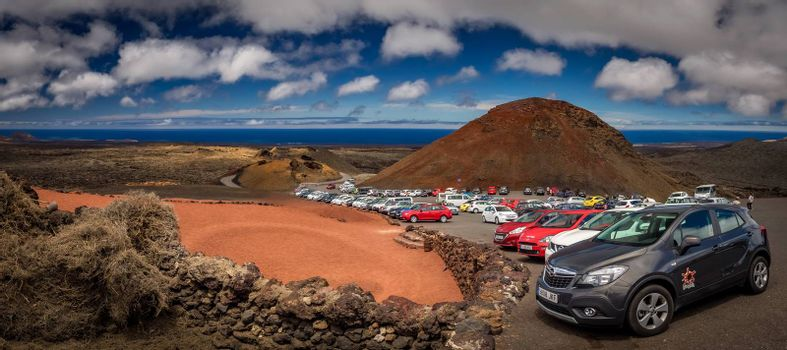 Car parked at the entrance to the Timanfaya National Park ( also called The Montanas del Fuego or Mountains of Fire ) in Lanzarote, Canary Islands, Spain. Picture taken 23 April 2016.