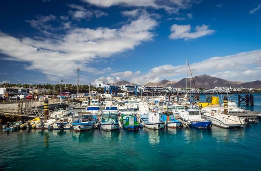 Colorful boats in a harbour in Playa Blanca, Lanzarote, Canary Islands, Spain. Picture taken 19 April 2016
