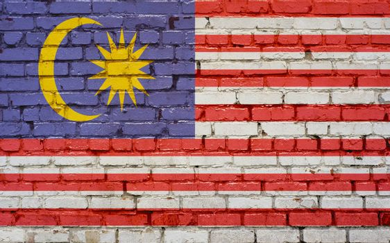 Flag of Malaysia painted on brick wall, background texture