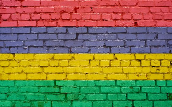 Flag of Mauritius painted on brick wall, background texture