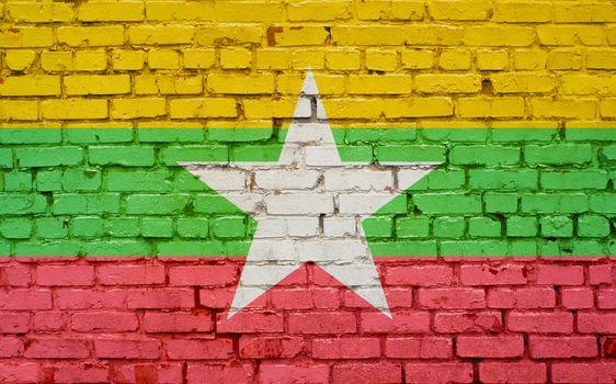 flag of Myanmar painted on brick wall