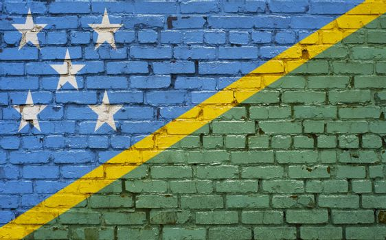 Flag of Solomon Islands painted on brick wall, background texture