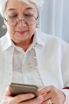 Senior woman using her mobile phone.