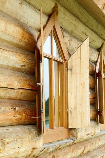 Old log chapel with an open window