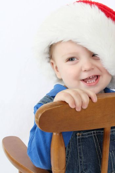 Cute baby boy wearing a christmas hat
