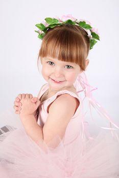 Toddler ballet girl in pink against white background